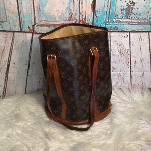 Tall Louis Vuitton Shoulder Bag.